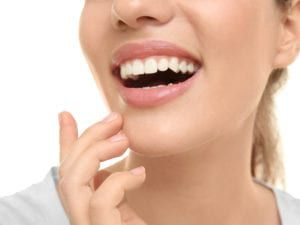 Woman with great smile after dental bonding