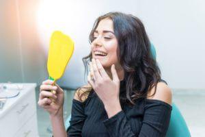 Woman admiring her new dental bondings