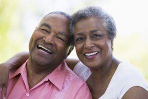 elderly black couple smiling