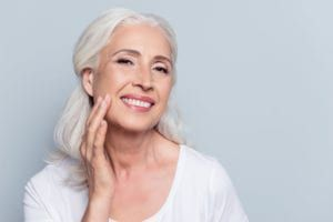 Woman smiling with new dentures