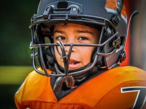Child in sports uniform