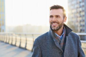 Man smiling on boardwalk