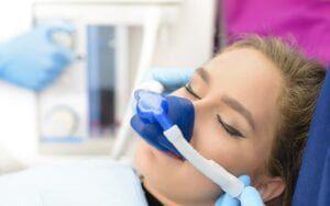 Woman undergoing sedation for dental care
