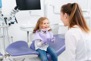 Small child in meeting with dentist